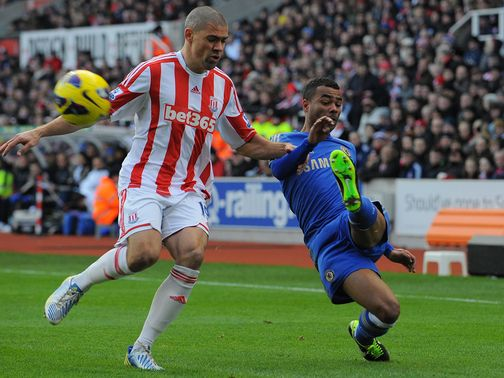 Jon Walters tries to stop Ashley Cole