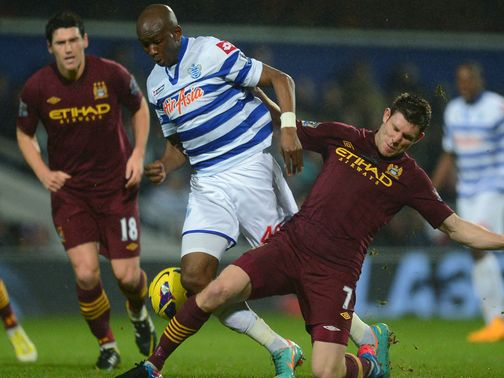 Stephane Mbia and James Milner battle for the ball