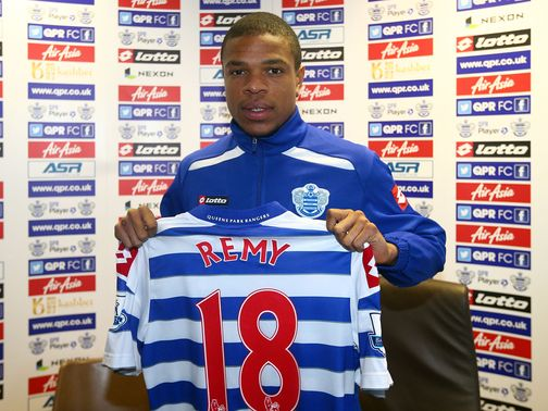 Loic Remy poses with his new QPR shirt.