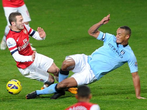 Vincent Kompany: Tackles Jack Wilshere on Sunday