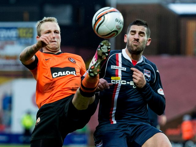 Johnny Russell and Evangelos Ikowomou battle for the ball
