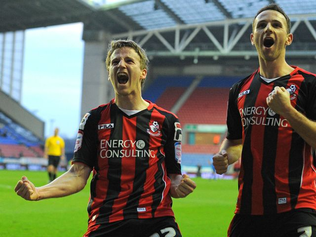 Eunan O'Kane and Marc Pugh celebrate for Bournemouth