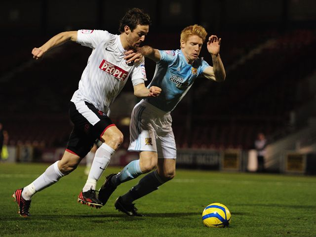 David Mooney tries to get past Paul McShane