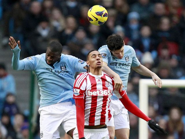 Nzonzi jumps with Toure and Barry