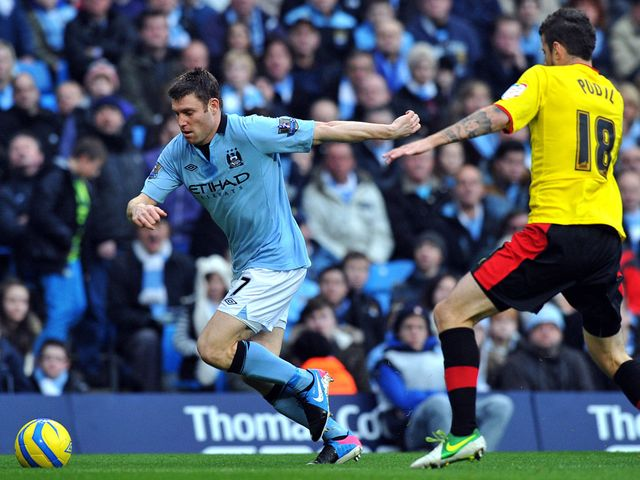 James Milner tries to get past Daniel Pudil