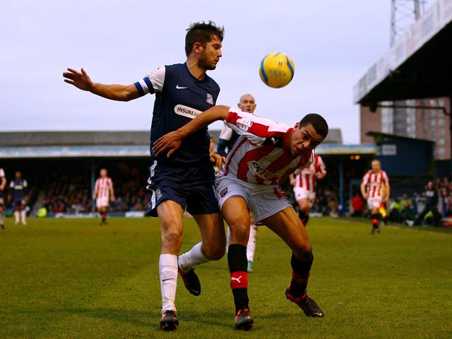 Mark Phillips and Tom Adeyemi battle for the ball