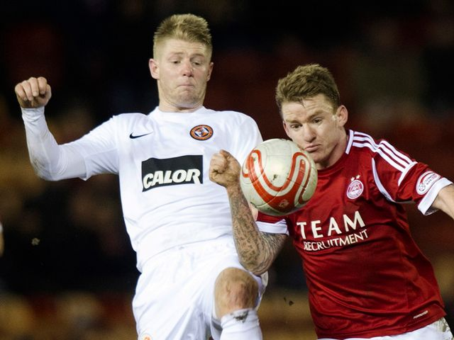 Stuart Armstrong tackles Jonny Hayes