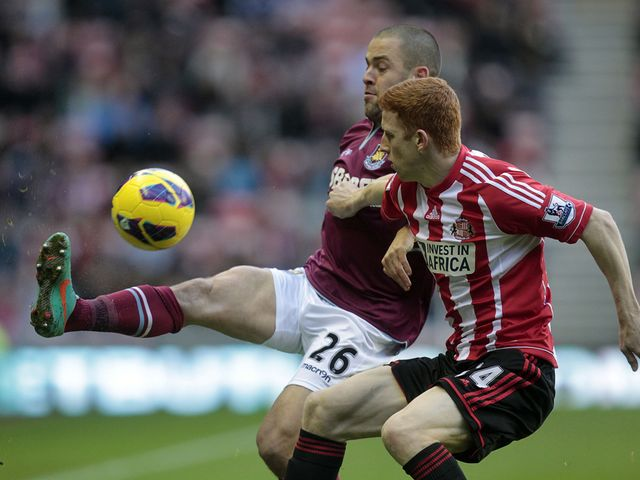 Joe Cole and Jack Colbeck battle for the ball