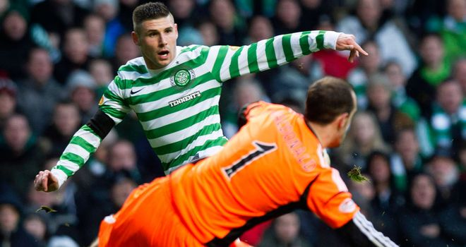 Gary Hooper scores his second goal against Hearts