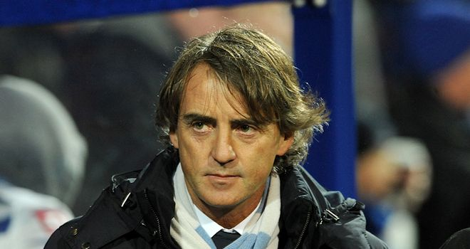 Man City boss Roberto Mancini met speculation over his future with swear words