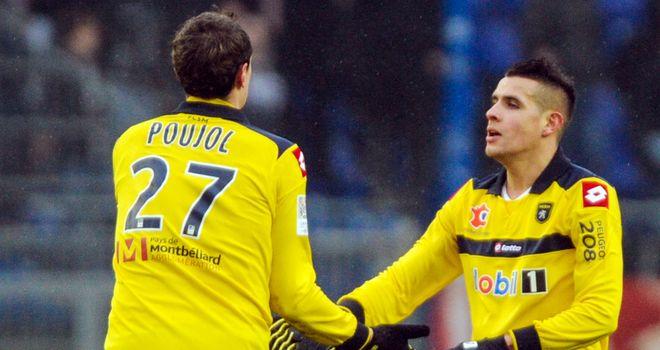 Loic Poujol (l) celebrates his vital goal