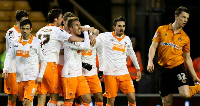 Tom Ince: Mobbed after brilliant two-goal display earned Blackpool victory