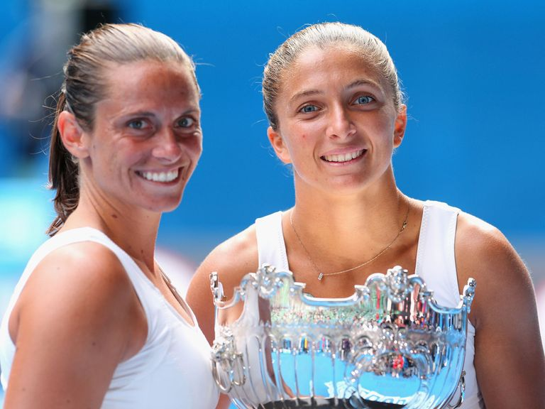 Roberta Vinci and Sara Errani celebrate.