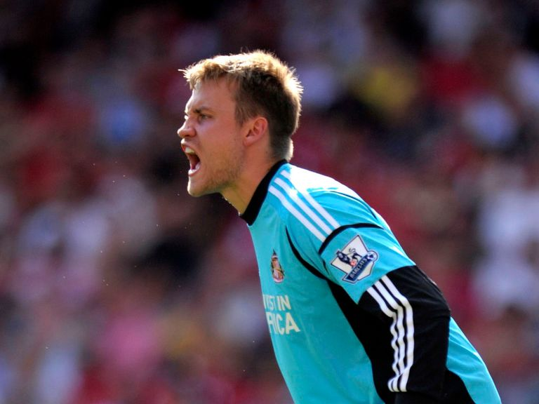 Mignolet is looking upwards rather than over his shoulder