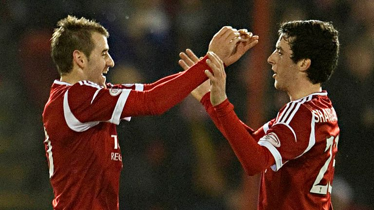 Niall McGinn: Celebrates his fine winner for Aberdeen