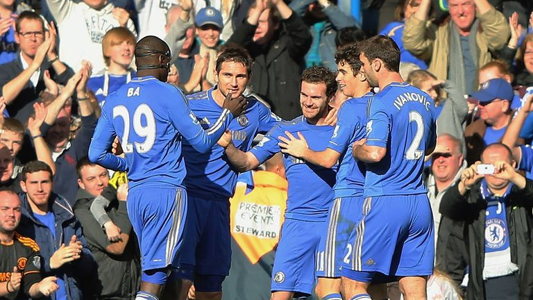 Juan Mata: Celebrates after opening the scoring at Stamford Bridge