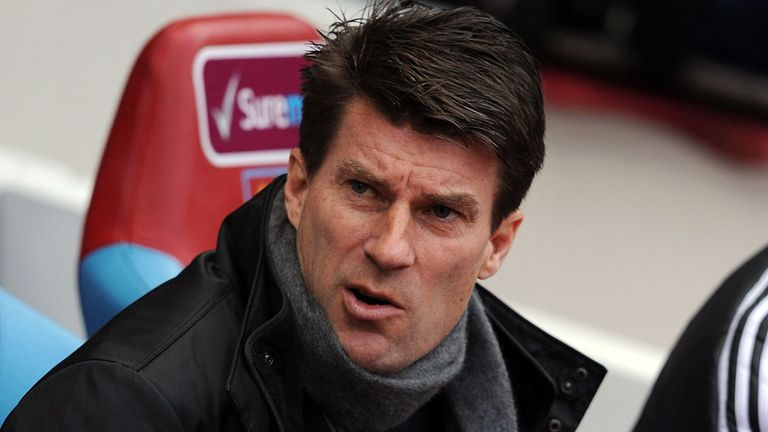 Michael Laudrup: Swansea manager staying put