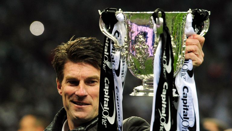 Swansea City manager Michael Laudrup celebrates with the trophy after the League Cup final