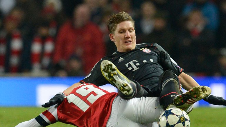 Bastian Schweinsteiger: Goes in for tackle against Arsenal