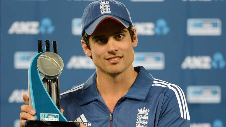 Alastair Cook poses with a new trophy for the England cabinet