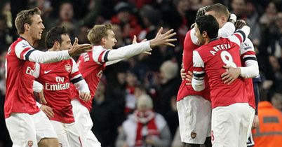 Nacho Monreal (l): Joins in with celebrations after Podolski's winner