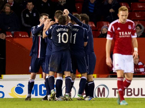Ross County celebrate Gary Glen's winning goal