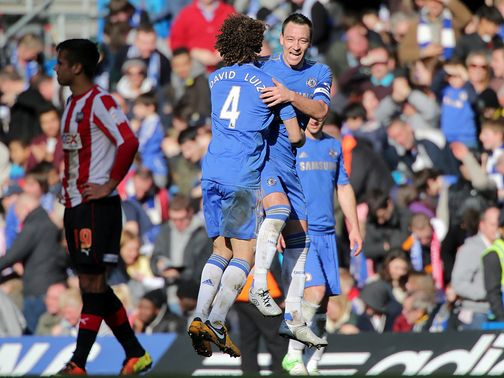 John Terry celebrates his goal in Chelsea's win against Brentford.