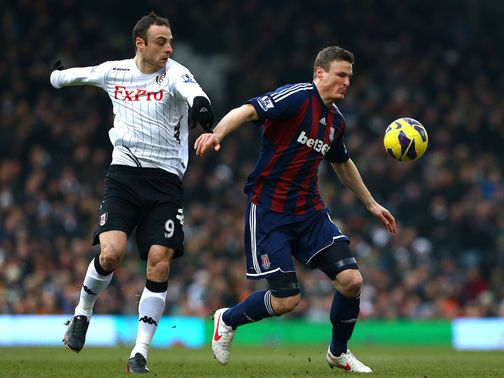 Robert Huth tries to hold off Dimitar Berbatov