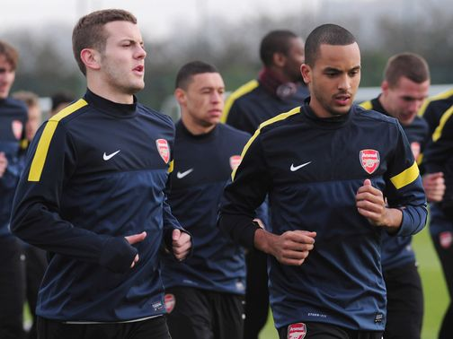 Jack Wilshere at training with Theo Walcott.