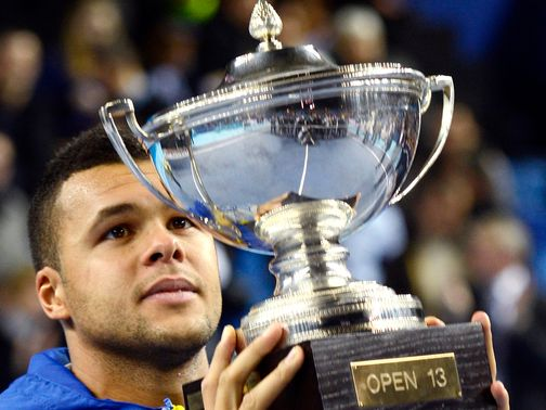 Jo-Wilfried Tsonga with the spoils of victory