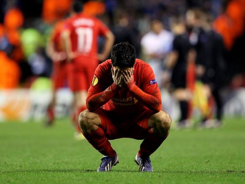 Luis Suarez shows his disappointment at the full-time whistle