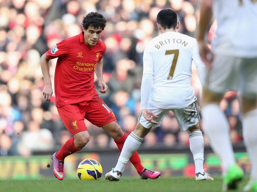 Philippe Coutinho in action during Liverpool&#39;s victory over Swansea.