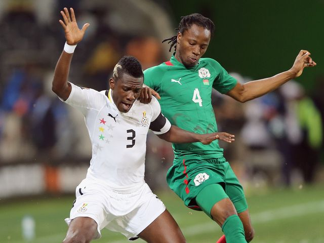 Gyan looks to hold the ball up for Ghana