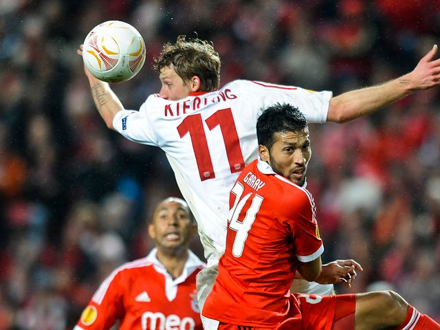Stefan Kiessling and Ezequiel Garay battle for the ball