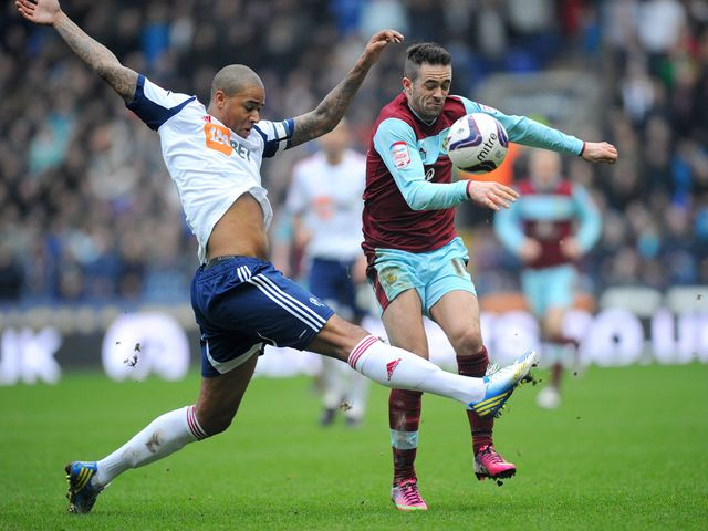 Zat Knight and Danny Ings battle for possession at the Reebok