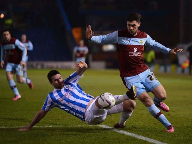 Anthony Gerrard tackles Burnley's Charlie Austin
