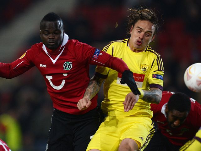 Andrei Eschenko vies for the ball with Didier Ya Konan