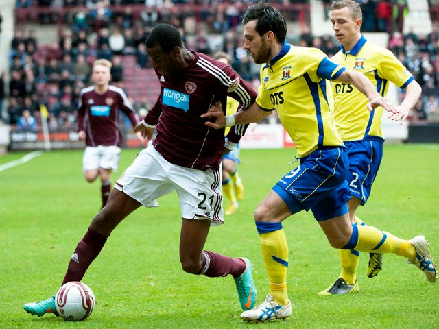 Michael Ngoo keeps possession.