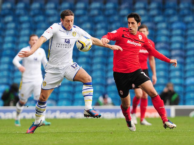 Michael Brown and Peter Whittingham tangle.