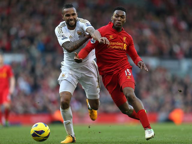 Bartley and Sturridge battle for the ball.
