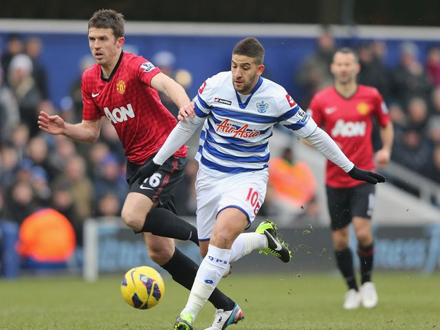 Adel Taarabt and Michael Carrick battle for the ball