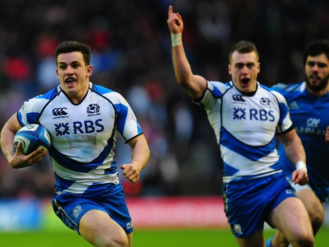 Scotland full-back Stuart Hogg celebrates as Matthew Scott runs in a try