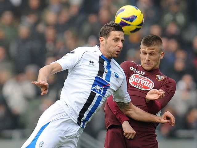 Riccardo Cazzola and Alen Stevanovic jump for the ball