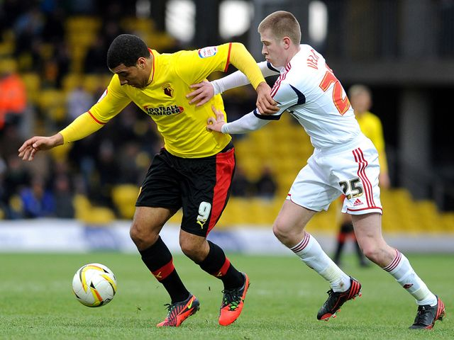 Troy Deeney bids to find space.