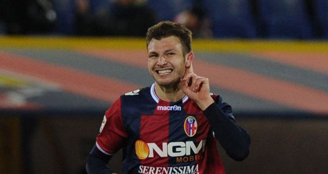 Marco Motta celebrates his goal for Bologna