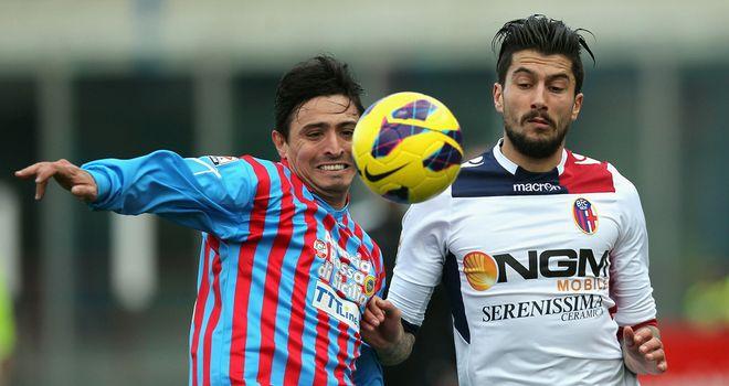 Pablo Alvarez and Panagiotis Kone challenge for the ball