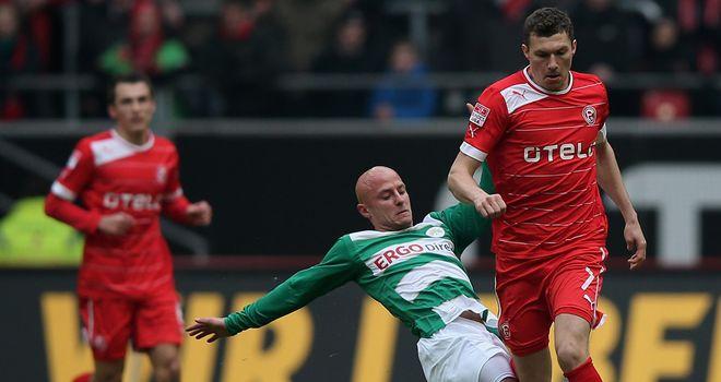 Jozsef Varga tries to tackle Oliver Fink.