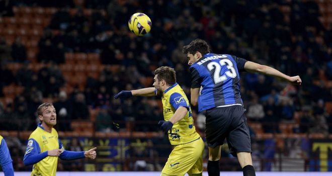 Andrea Ranocchia heads home for Inter.