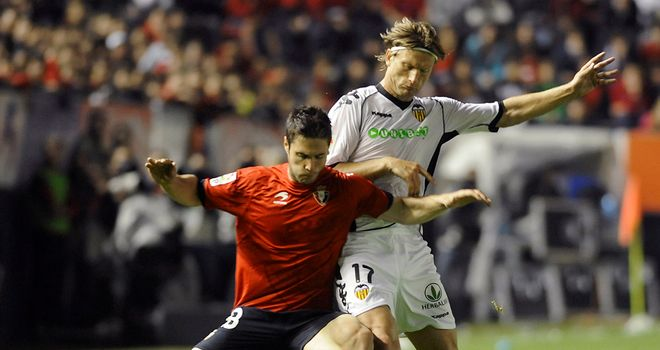 Kike Sola (left): Vital goal for struggling Osasuna