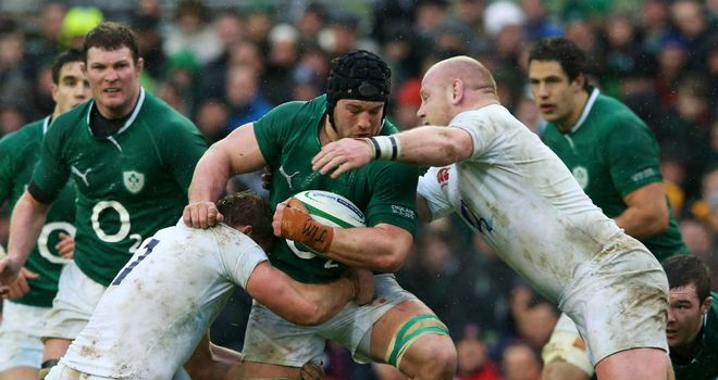 Ireland's Sean O'Brien is tackled by Chris Robshaw and Dan Cole